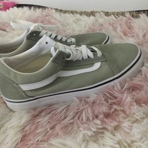 Green and white vans